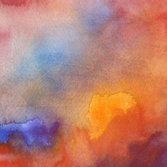 Colorful watercolor texture with abstract washes and brush strokes on the white paper background.