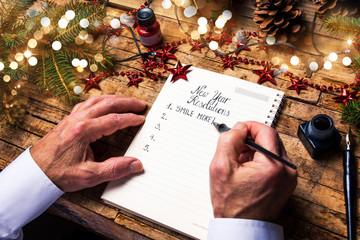 Senior writing new year resolutions