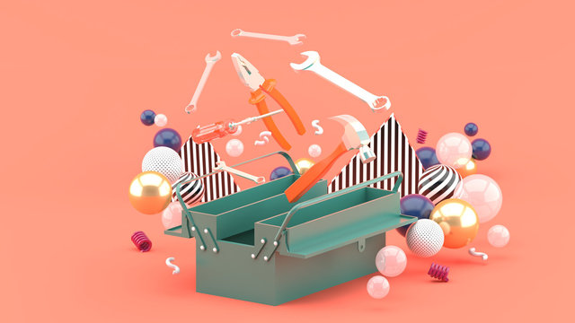 Toolbox amidst colorful balls on a pink background.-3d rendering.