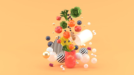 Fototapeta The food floats out of the capsule amidst colorful balls on the orange background.-3d render.. obraz