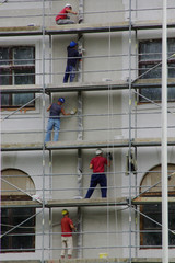 Painter at work on a scaffolding on a building