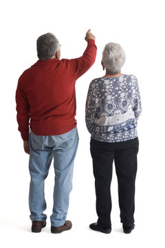 couple pointing on white