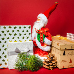 Santa Claus figure standing on a golden gift box