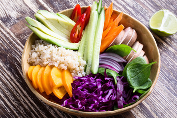 Quinoa veggie bowl with colorful fresh vegetables and fruits