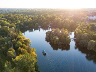 Wall Mural - Beautiful countryside landscape picturesque river with ships, green forest with summer sky at sunset. Aerial view from drone at Sofiyivsky park, city Uman, Ukraine