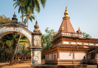 Ancient Hindu Shree Morjai Temple amidst a coconut grove. In the temple celebrate Kalas Utsav. The walls are adorned with the rare and extinct Kaavi art friezes. Morjim, Goa, India
