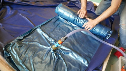 Emptying and dismantling a PVC waterbed mattress