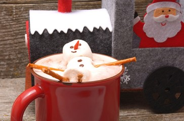 Red cup with hot chocolate and christmas decoration