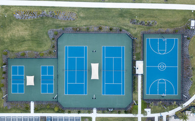 Aerial View of a Blue Tennis and Basketball Courts