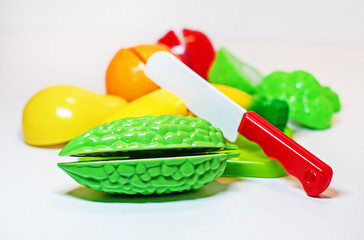baby toys vegetables and fruits on white background