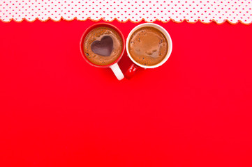 Cup of coffee on the red background
