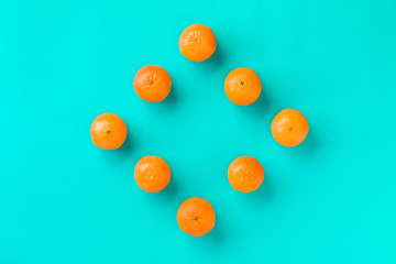 Fruit pattern of mandarin isolated on blue background. Tangerine. Flat lay, top view.