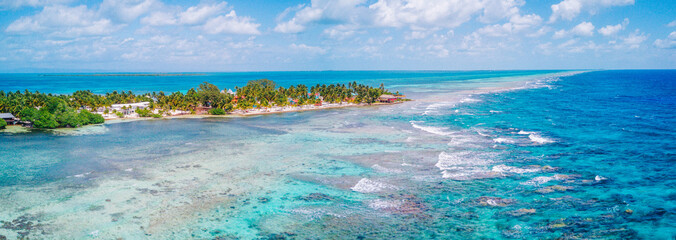 Aerial Drone view of South Water Caye tropical island in Belize barrier reef. A typical Caribbean island with turquoise water