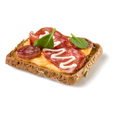 Canape with salami. Open faced sandwich crostini isolated on white background closeup. Appetizer tartarine.
