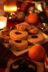 Christmas still-life with candle-light atmosphere and homemade cookies (low light)