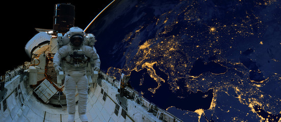 Fotorolgordijn Nasa astronaut spacewalk at night from the dark side of the earth planet. Elements of this image furnished by NASA d