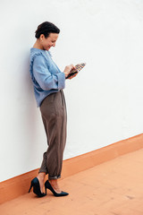 Elegant adult woman in heels outdoors