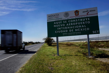 View of airport construction sign beside highway in Texcoco