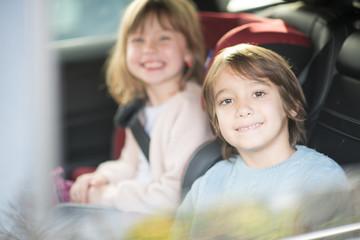 kids  sitting together in modern car