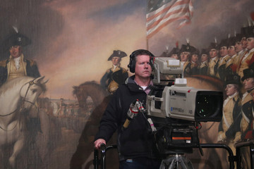 Cameraman sets up prior to arrival of  casket of late U.S. President Bush inside Capitol Rotunda in Washington