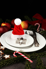 Festive table setting for xmas with fork, knife, nuts and apples a christmas dish concept