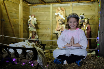 Young girl dressed as an angel in a Nativity scene at Christmas in Australia