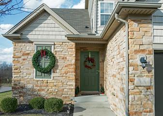 Stone & Shake House Entrance with Christmas Wreaths