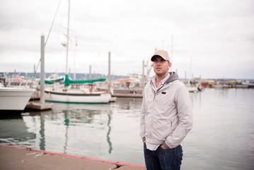 A portrait of a man at a marina