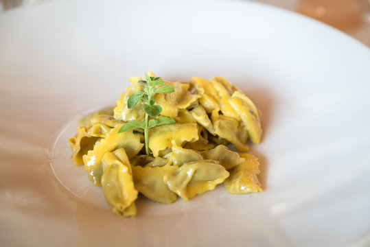 traditional italian agnolotti pasta in a plate in a restaurant