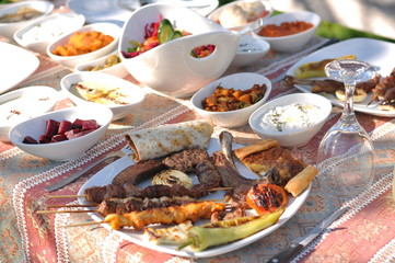 Garden Poster Cyprus Traditional Cypriot meze and kebap barbecue party in the garden with delicious mix meat and chicken kebaps