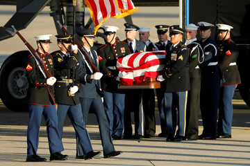 Military honor guard carries the casket of former U.S. President George H.W. Bush at Joint Base Andrews, Maryland