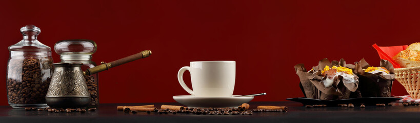 Coffee panorama with a white mug and muffins on a red background