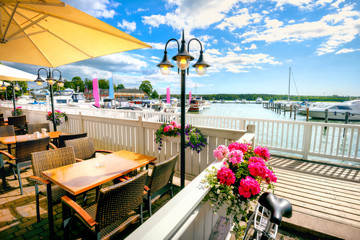 Fototapeten Skandinavien Seafront with cafe and marina in Naantali town at sunny summer day. Finland