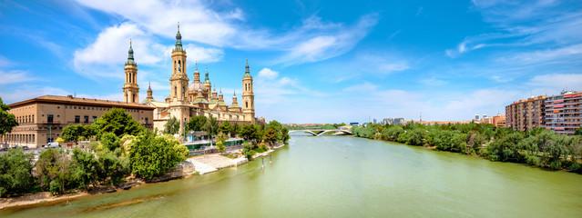 Wall Mural - River Ebro and Our Lady El Pillar basilica in Zaragoza, Spain .