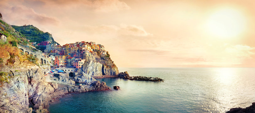 Seascape with town on rock of Manarola, at famous Cinque Terre National Park. Liguria, Italy