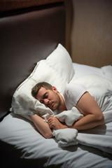 Man sleeps in his bed