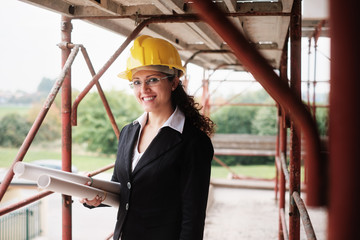 Happy Woman Working As Architect In Construction Site