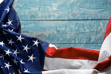 American flag on wooden background, top view with space for text
