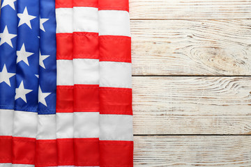 American flag on white wooden background, top view with space for text