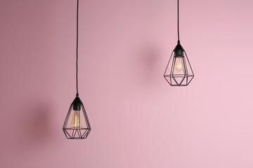 Modern hanging lamp on color background. Idea for interior design