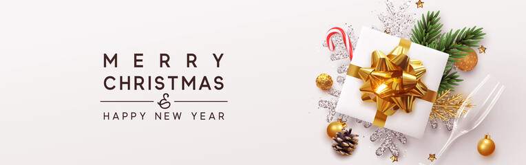 Happy New Year banner, Xmas bauble with gifts box and snowflake glitter, glasses champagne. Horizontal Christmas posters, greeting cards, header, website. Objects viewed from above. Flat lay, Top view