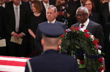 Justices of the U.S. Supreme Court stand at casket of former U.S. President Bush in Capitol Rotunda in Washington