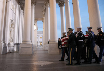 A military honor guard team carries the casket of former U.S. President George H. W. Bush into the U.S. Capitol in Washington