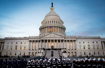 The casket carrying former president George Herbert Walker Bush is carried up the steps of the US Capitol in Washington