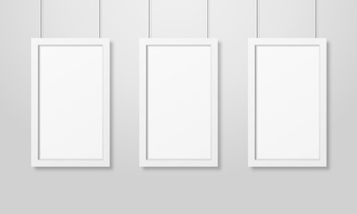 Three Vector Realistic Modern Interior White Blank Wooden Poster Picture Frame Set Hanging on the Ropes on White Wall Mock-up. Empty Poster Frames Design Template for Mockup, Presentation