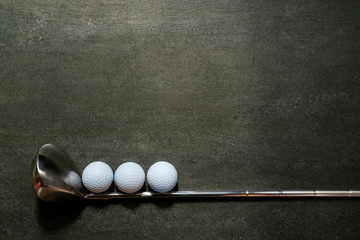 Poster Golf golf ball and golf club on black background