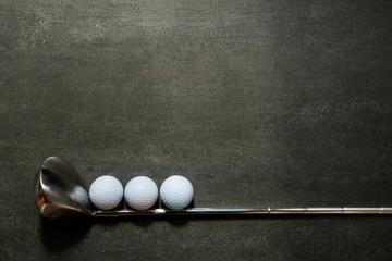 Foto op Aluminium Golf golf ball and golf club on black background