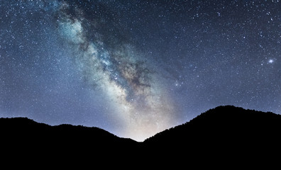 Night landscape with colorful Milky Way over Mountains