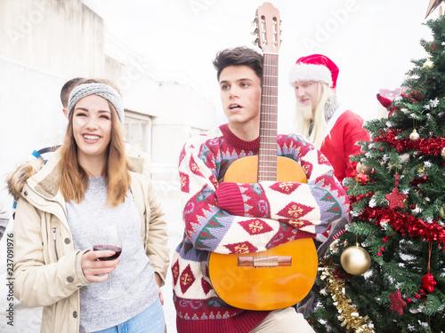 Fotos Cena Navidad Frinsa.Young Man With Guitar Celebrating Christmas Outdoors With