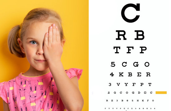 eyesight check. girl covering one eye with hand. ophthalmology concept.